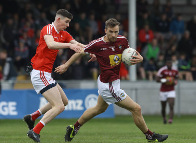 Louth's Ciaran Downey tackles Kevin Maguire of Westmeath.
