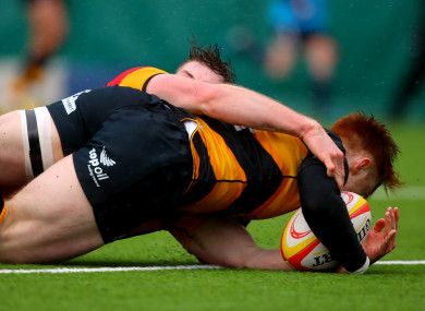 Conor Phillips  scores a try for Young Munster.