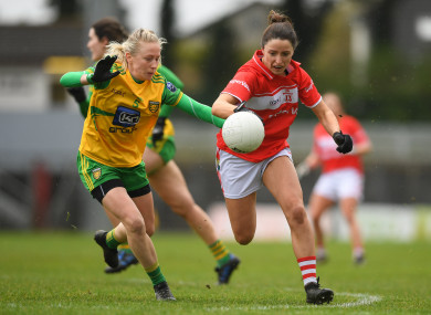 Eimear Scally of Cork in action against Treasa Doherty of Donegal.