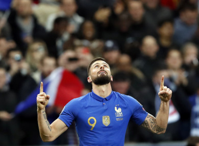 The striker celebrates his goal.