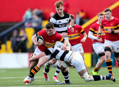 CBC's Harry O'Riordan is tackled by John Forde.