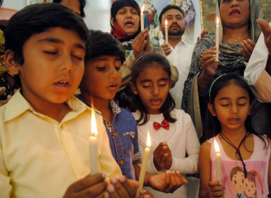 Christians attend a special prayer service for the victims of Christchurch mosques shooting, at a church in Hyderabad, Pakistan.