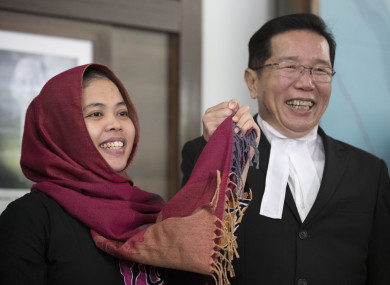 Indonesian Siti Aisyah, left, smiles with her lawyer Gooi Soon Seng after a press conference at Indonesian Embassy in Kuala Lumpur, 11 March.