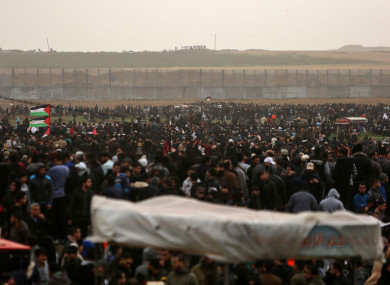 Palestinian protesters clash with Israeli troops on the Gaza-Israel border.
