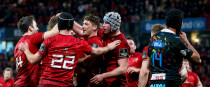 Munster's Mike Haley celebrates scoring a try with team-mates.