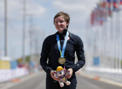 United States gold medalist Kelly Catlin poses after winning the women's individual time trial cycling competition at the Pan Am Games in Milton, Ontario in 2015.