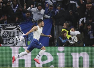 Porto defender Alex Telles celebrates after scoring his side's third goal.