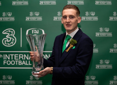 Ronan Curtis holds his U21 award, with heavily bandaged finger.