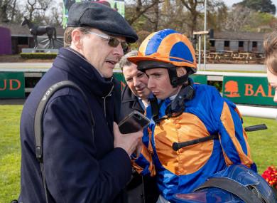 Aidan O'Brien speaks with jockey Ryan Moore.