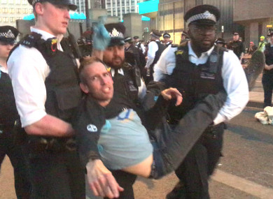 Screengrab from a video of Olympic gold medallist Etienne Stott being arrested by police at the Extinction Rebellion demonstration on Waterloo Bridge in London.