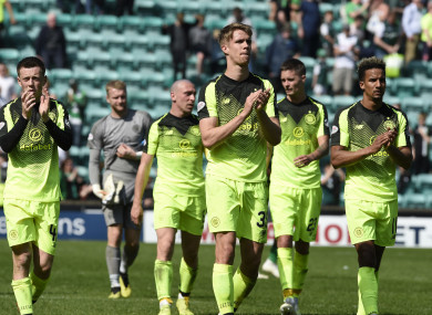 Celtic players react after the game.