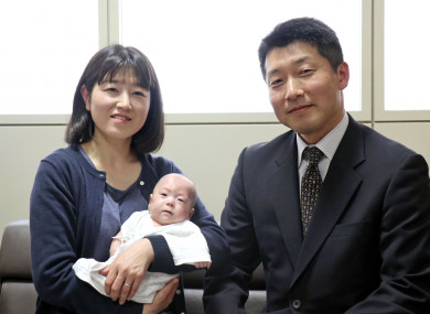 Ryusuke Sekino, a 5-month-old boy who is the world's smallest boy, pictured with his parents