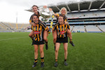 Anna (l) and Shelly (r) on their team-mate's shoulders after the 2016 All-Ireland final win.