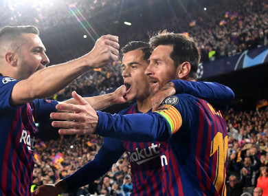 Lionel Messi (R) leads celebrations against Manchester United.