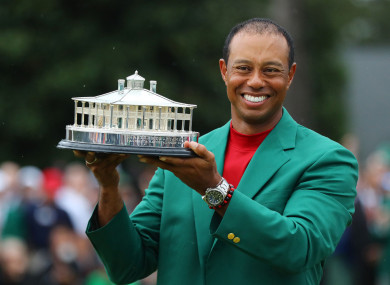 Woods claimed a fifth Green Jacket yesterday.