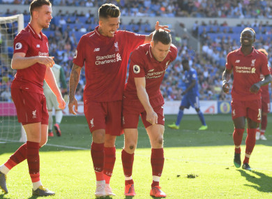 James Milner celebrates in unique fashion after scoring for Liverpool at Cardiff City.