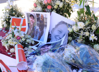 Flowers and posters placed in a gathering in support of the families of two murdered foreign tourists in Imlil, Morocco