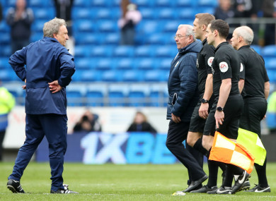 The Cardiff boss along with the match officials after the defeat to Chelsea.