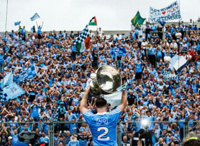 Dublin's Philly McMahon parades Sam Maguire in front of Hill 16 last September.