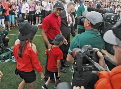 Woods celebrates with his children at Augusta.