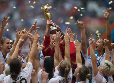 The US team lift the World Cup trophy in 2015.