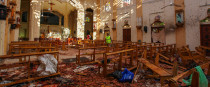 Sri Lankan soldiers look on inside the St Sebastian's Church, where a bomb exploded on Easter Sunday