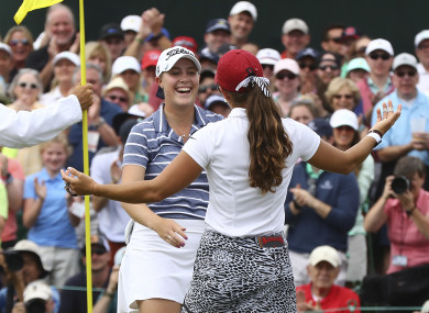 Kupcho gets a hug from Maria Fassi after sinking her birdie putt on the 18th green.