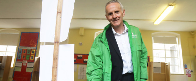Green candidate Ciarán Cuffe voting in Dublin yesterday.
