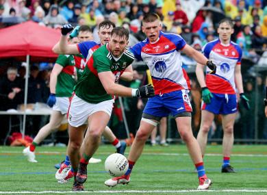 Aidan O'Shea and Matthew Queenan battle for possession.