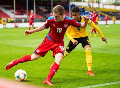 Czech Republic's Josef Koželuh under pressure from Rob Nizet of Belgium.
