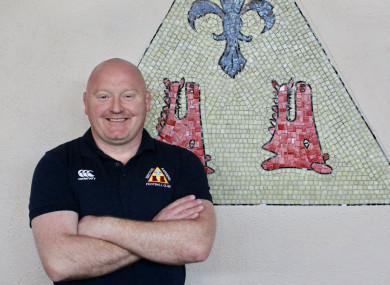 Bernard Jackman poses in front of the Bective club crest.