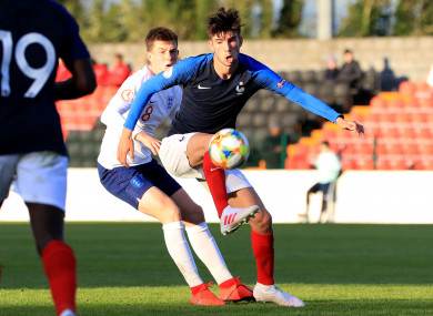 Theo Zidane of France in possession, with England's Jensen Weir paying close attention.
