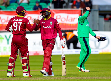 West Indies celebrate their win in Malahide.