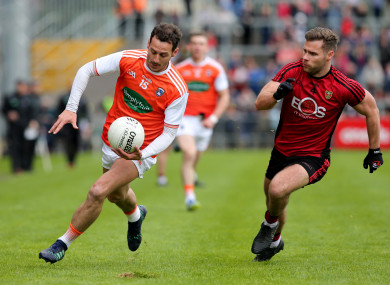 Gerard Collins chases after Jamie Clarke.