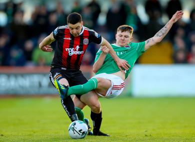 James Tilley of Cork challenges Bohs' Kevin Devaney.