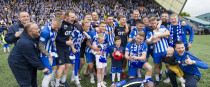 The Kilmarnock squad celebrate after securing Europa League qualification by defeating Rangers on Sunday.