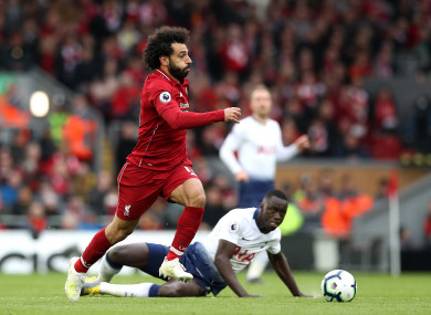 Liverpool's Mo Salah and Davison Sanchez of Spurs.