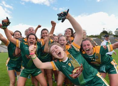 Meath players celebrate their league glory.