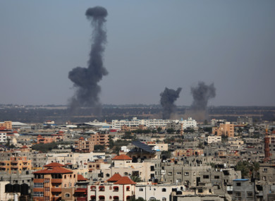 Smokes and flames rise after an Israeli air strike in Gaza.