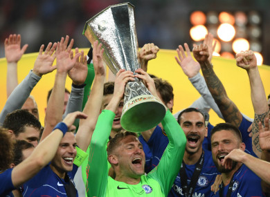 Green lifts the Europa League trophy surrounded by his Chelsea team-mates.