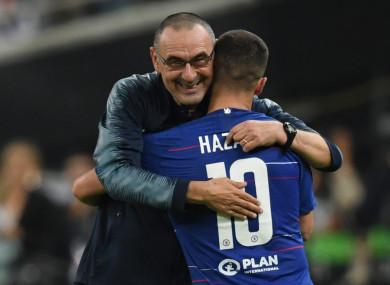 Maurizio Sarri (L) embraces Chelsea's Eden Hazard.