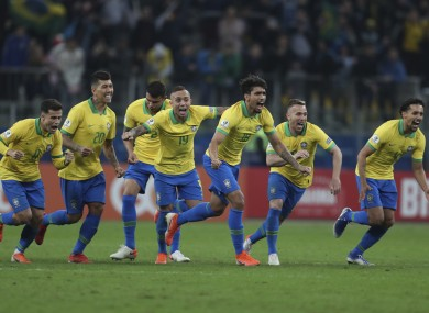 Brazil celebrate winning at the end of the shootout.