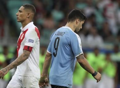 Luis Suarez walks away after his penalty miss.