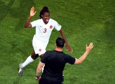 Canada's Kadeisha Buchanan (left) celebrates scoring her side's first goal of the game.