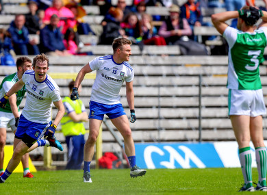 Monaghan's Conor McCarthy celebrates scoring a goal with Jack McCarron.