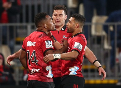On track: Crusaders players celebrate.
