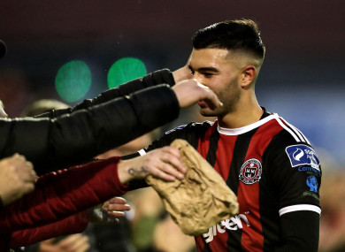 Bohemians' Danny Mandroiu celebrates after the game with fans.