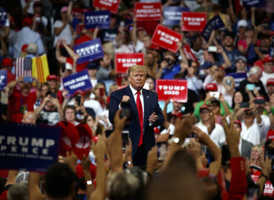 President Donald Trump pumps his fist after speaking during his re-election kickoff rally in Florida