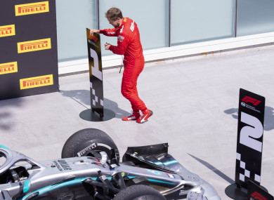 Vettel moving the number one sign to where his car should have been.