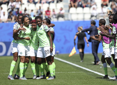 Nigeria players celebrate after taking the lead.